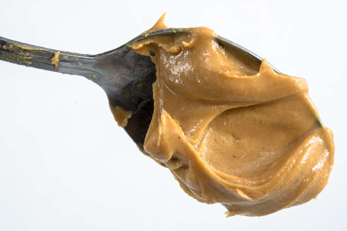 Close up of peanut butter in a spoon phobia arachibutyrophobia