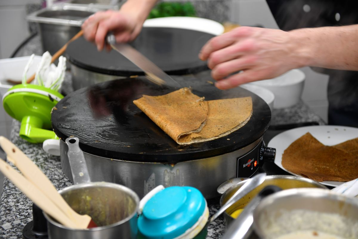 Cooking a crepe A competitor attends the contest of the best crepe maker of Brittany at the Apprentice training center in Saint-Jouan-des-Guérets cooking tips meal prep