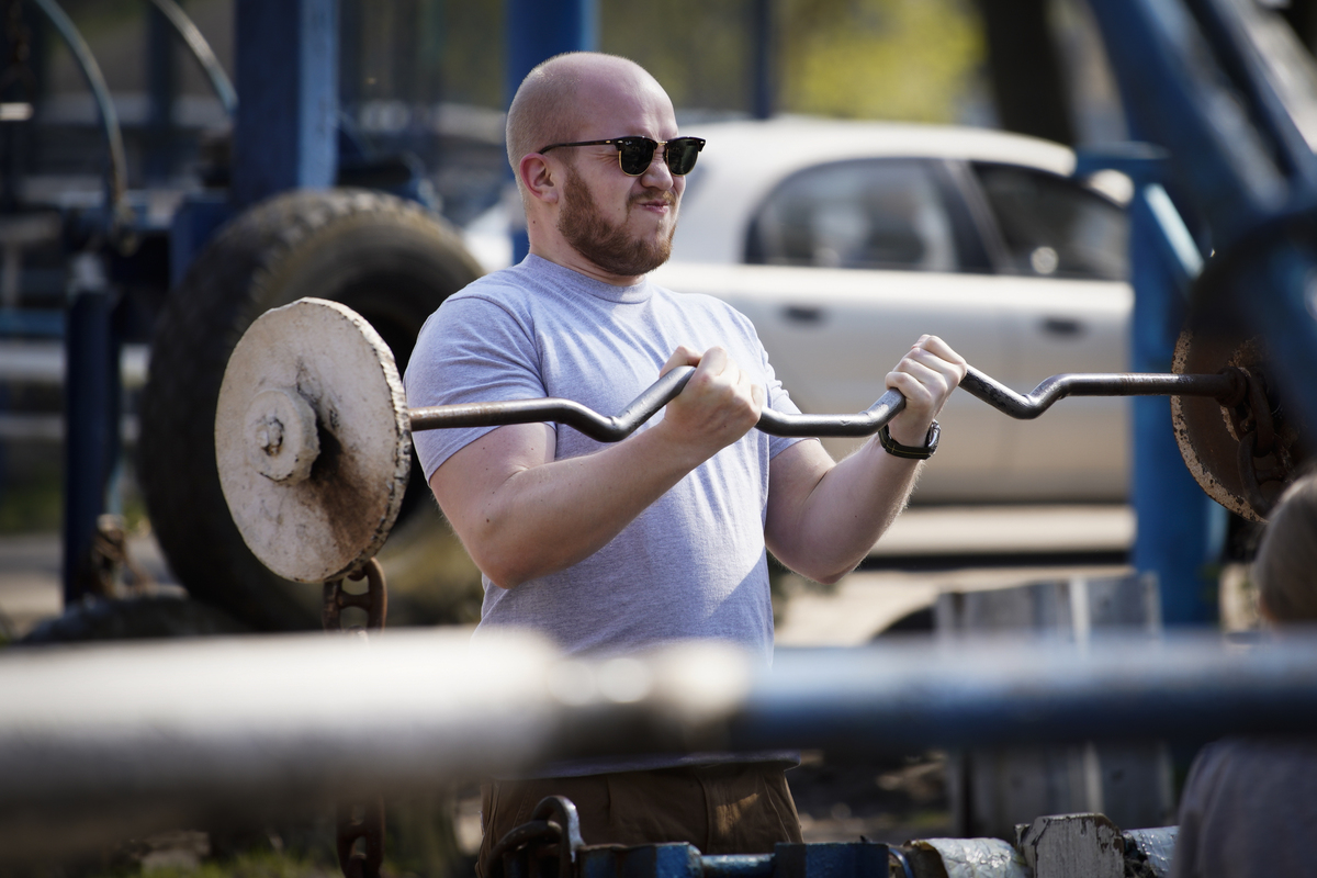 A man is seen exercising at the Kachalka outdoor scrapyard gym in Kyiv, Ukraine