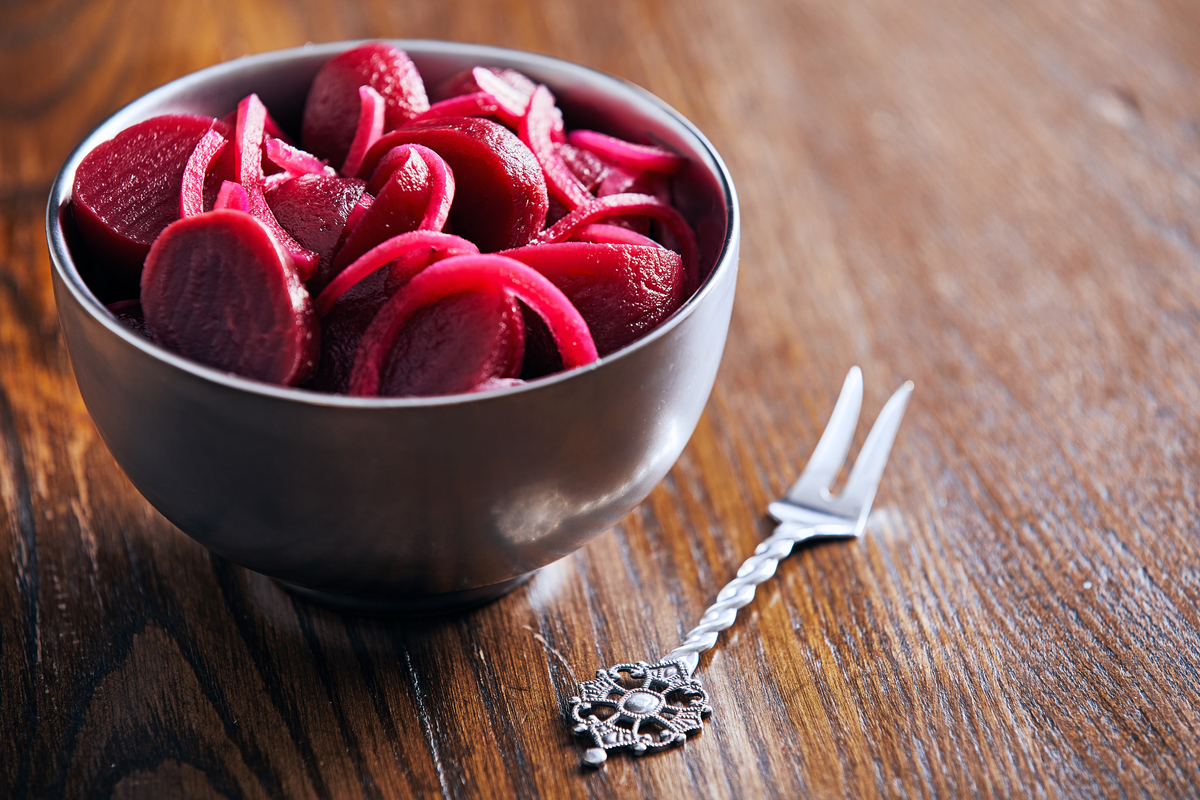Pickled Beets in a bowl with a fork next to it