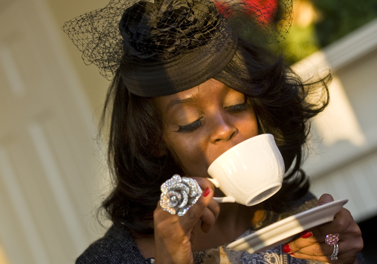 Mariessa Terrell sips some peppermint tea at High Tea put on by girls that are mentored through The High Tea society.