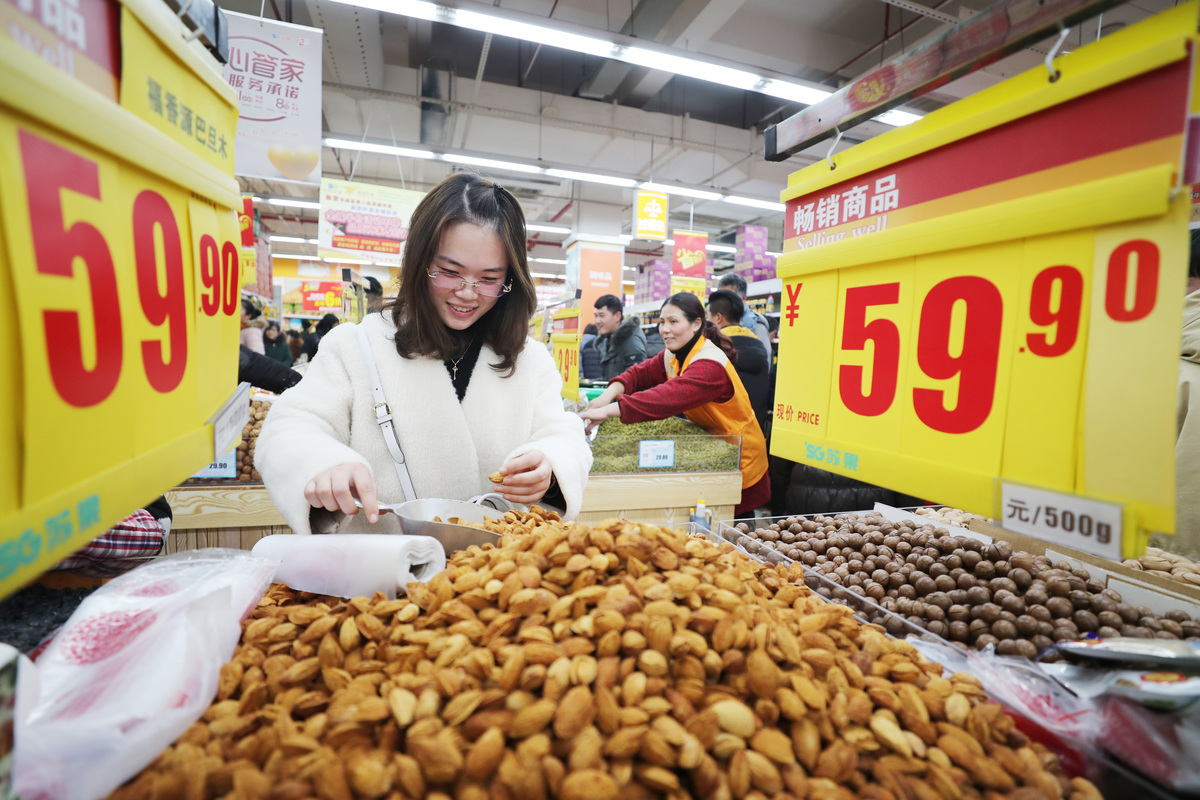 A citizen purchases nuts at a supermarket in China