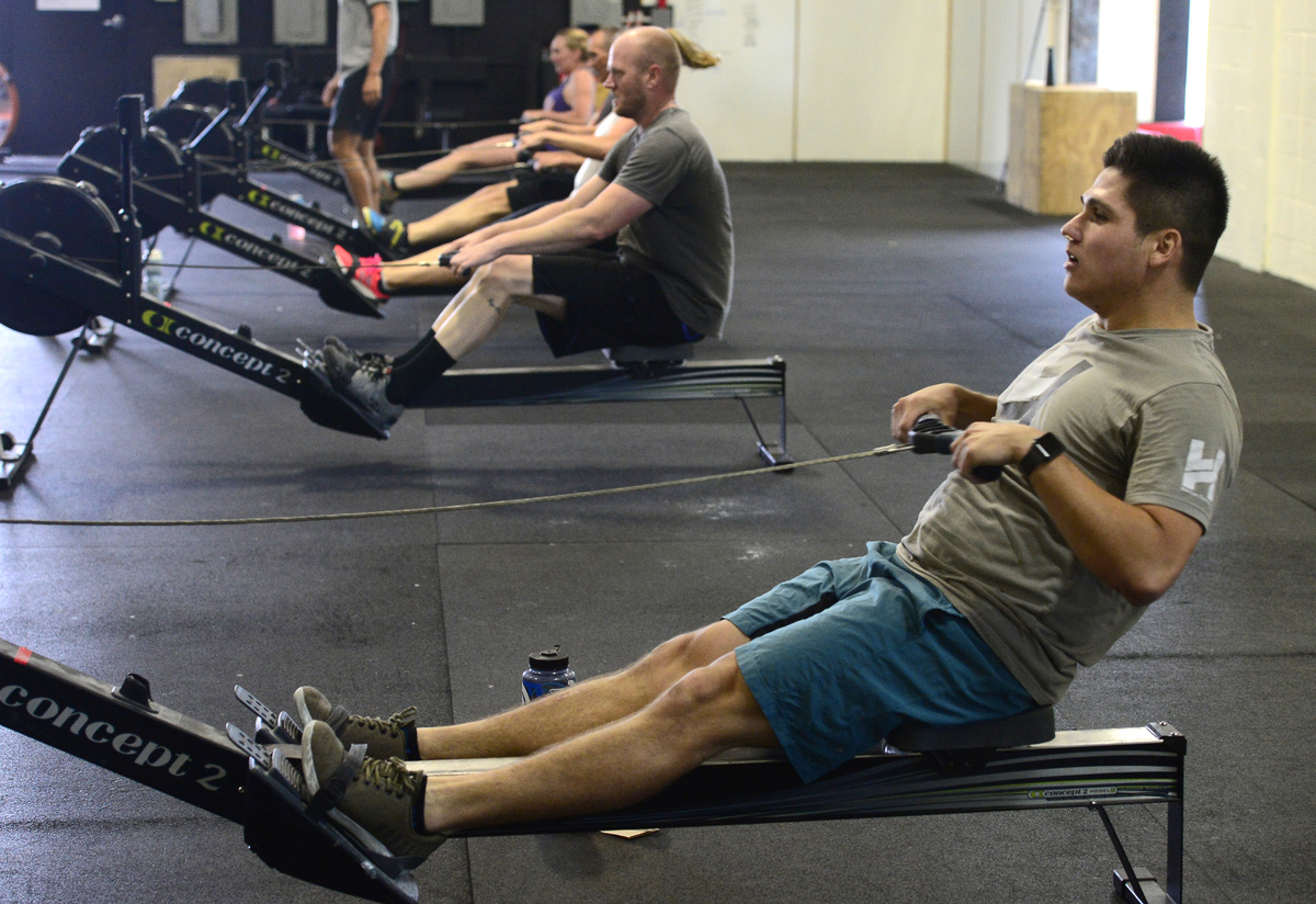 Emmett Elizondo, works on the rowing machine during class at CrossFit Lefthand in Boulder.