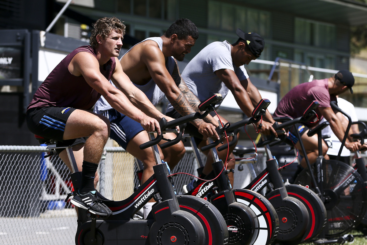Richard Judd, Vaea Fifita and Sam Lousi ride stationary bikes during the Hurricanes Media Session at Rugby League Park on February 05, 2019 in Wellington, New Zealand.