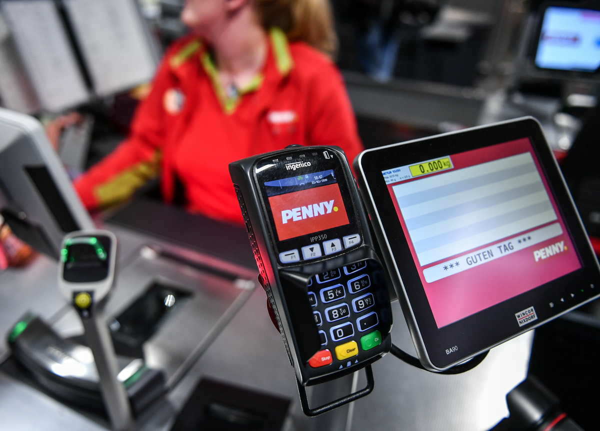 A card reader at the cash register in the grocery discounter Penny