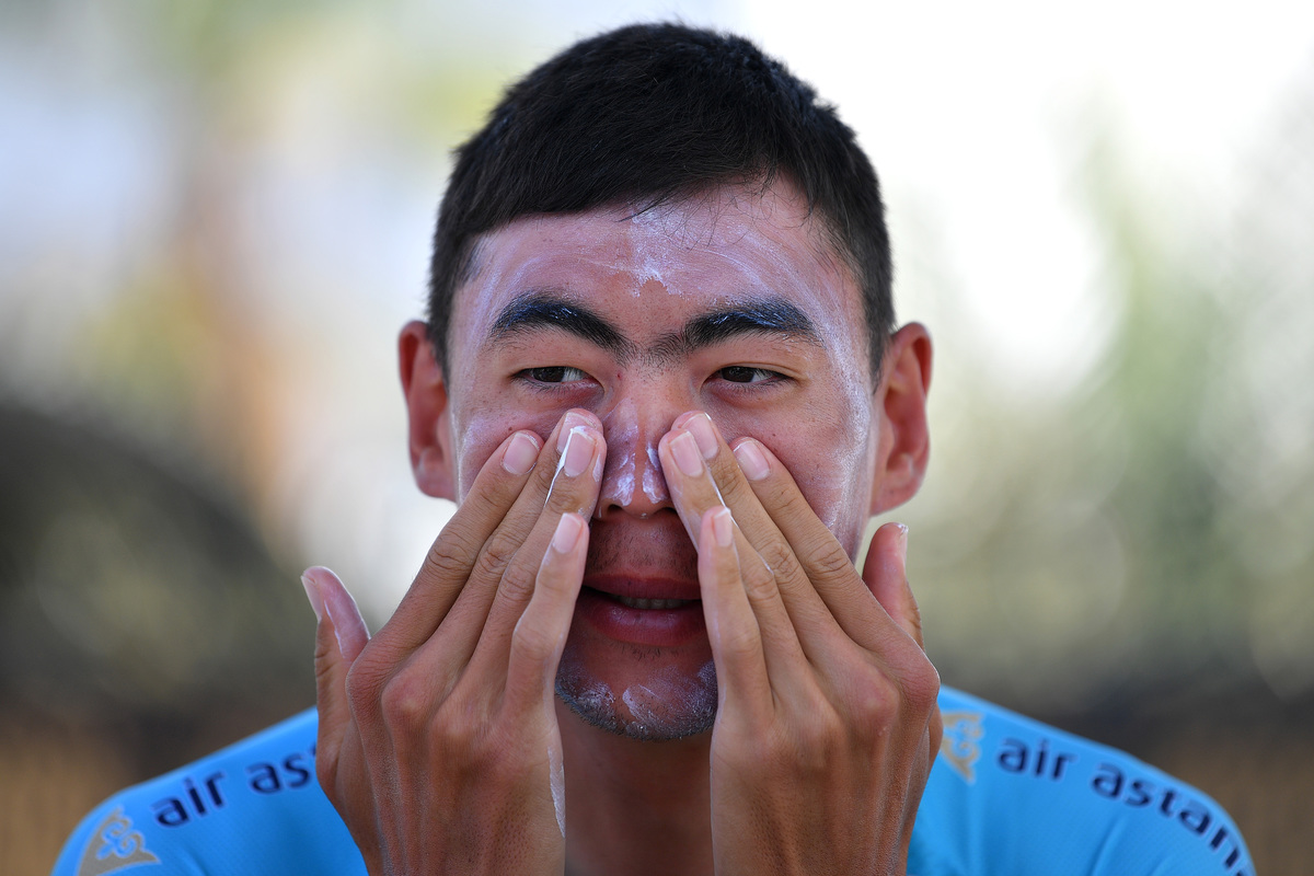 Zhandos Bizhigitov of Kazahkstan and Astana Pro Team putting on sunscreen