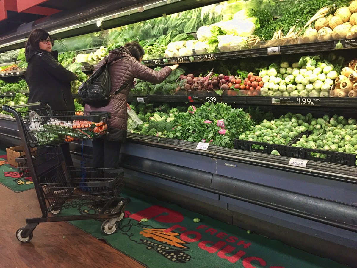 Women shop for vegetables in a grocery store in Toronto, Ontario, Canada