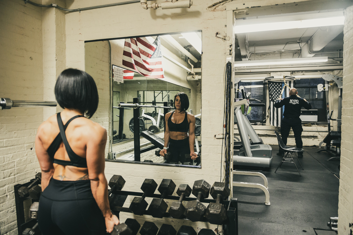 NYPD officer Julissa Camacho works out at the 44th precinct gym in the Bronx, New York on April 3, 2019.