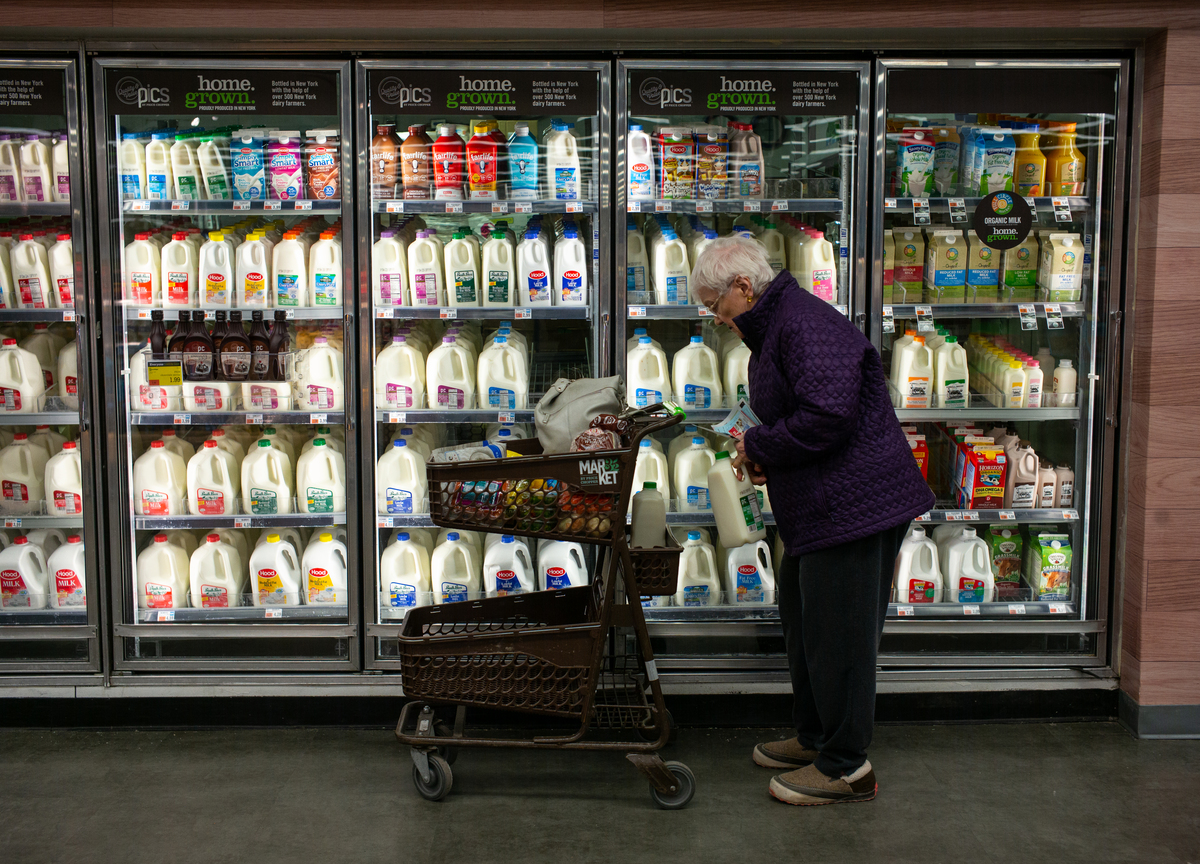 A woman shops for milk at the Price Chopper grocery store in South Burlington, Vermont