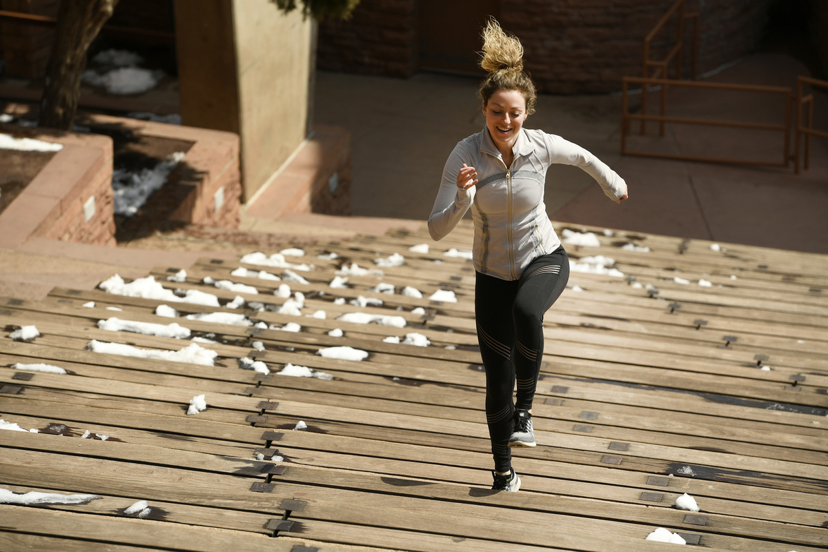 Jessica Santoro does sprints up the stairs inside Red Rocks Amphitheatre on March 31, 2019 in Morrison, Colorado.