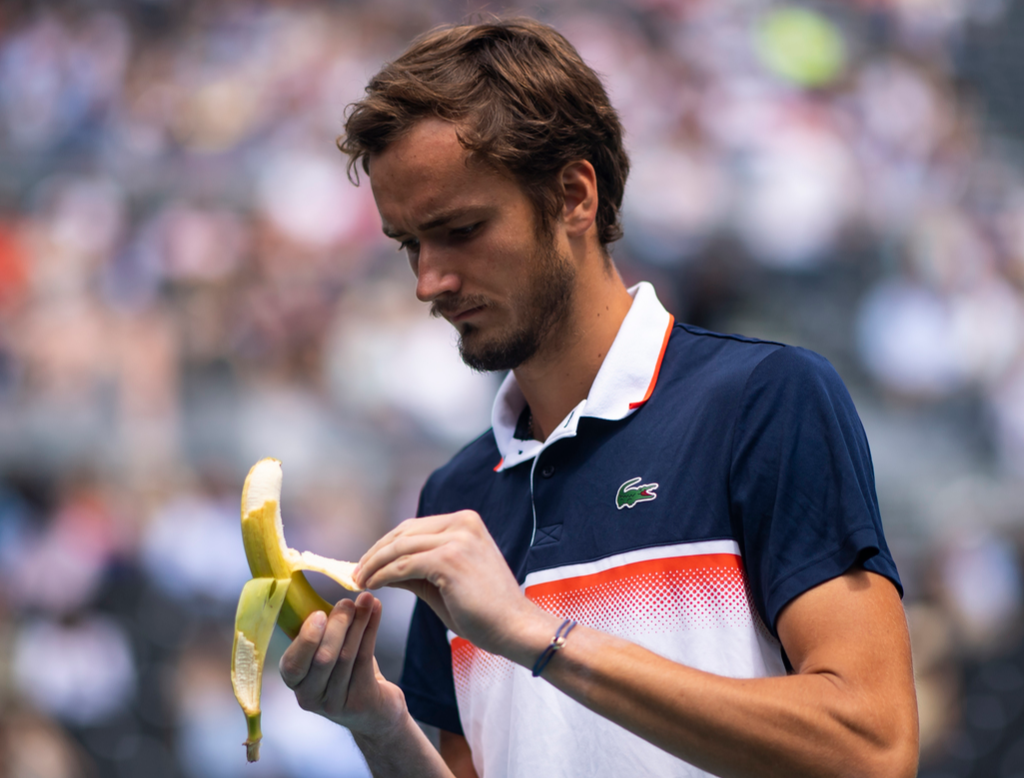 Daniil Medvedev of Russia eats a banana during a change of ends during his match
