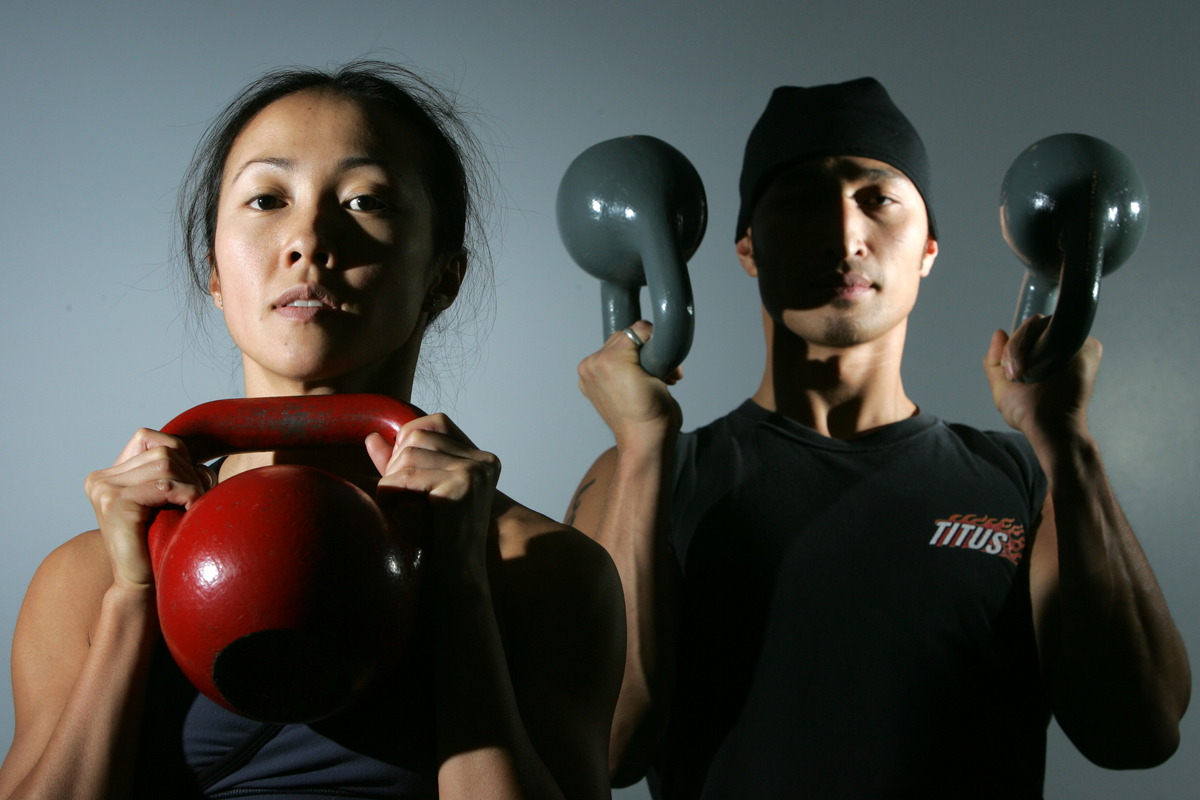 irginia Lee and Edwin d Lleon show their form as demonstrating an ancient Russian form of exercise that uses kettlebells.
