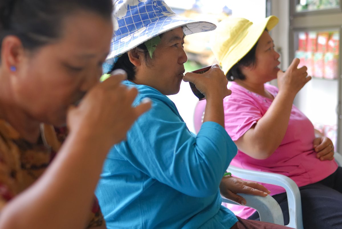 Thai customers sip oolong tea at the Yeng Hong Tea Factory
