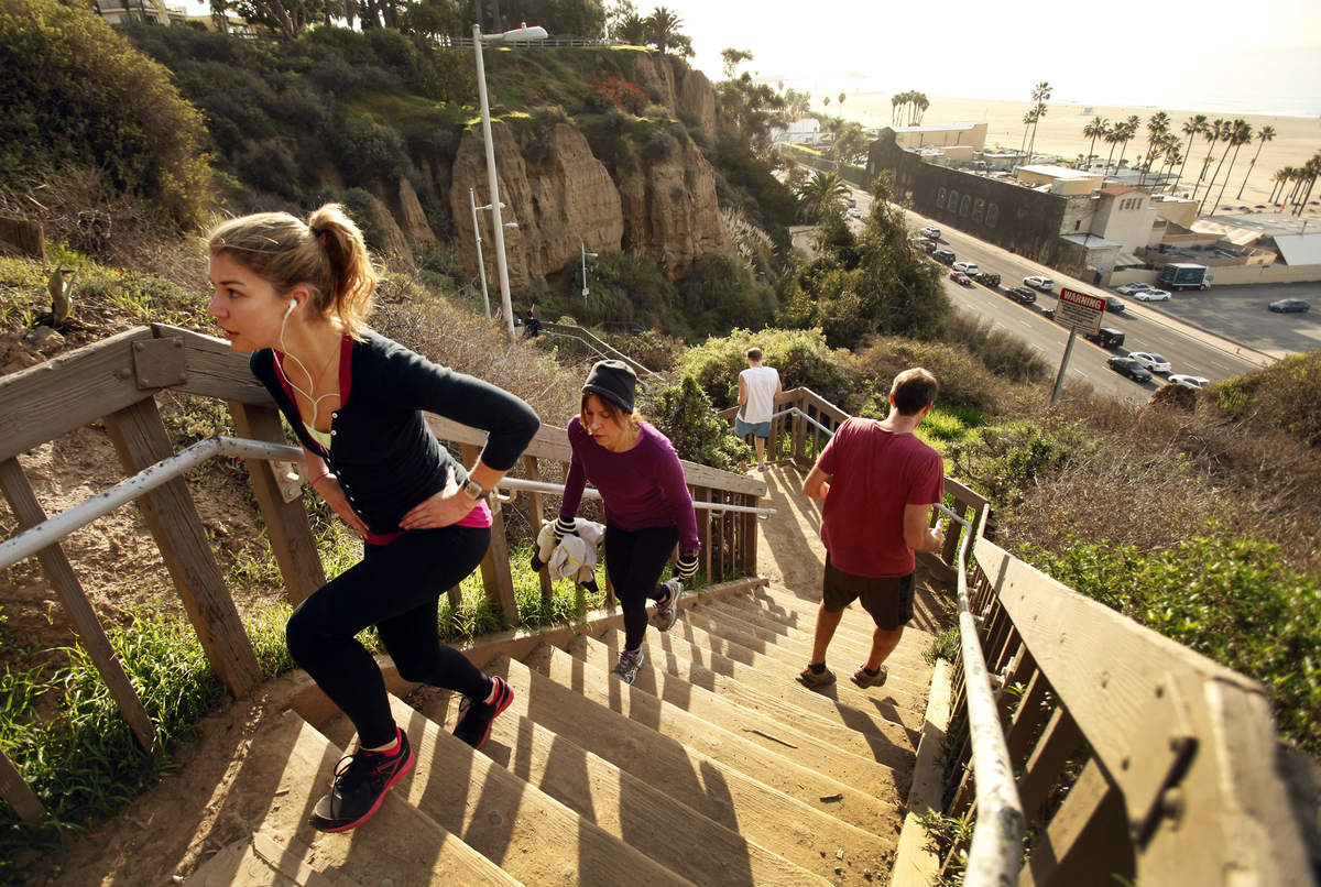 Samantha Terrio, left, climbs the stairs during a workout as a student in Angela Parker's Body Inspired Fitness class at Palisades Park along Ocean Avenue in Santa Monica Wednesday morning January 09, 2013.