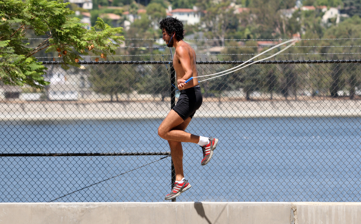 Orlando Tirado, 30, practices his balance by jumping rope on a concrete wall next to the Silver Lake reservoir along Silver Lake Blvd in Los Angeles on August 10, 2012.