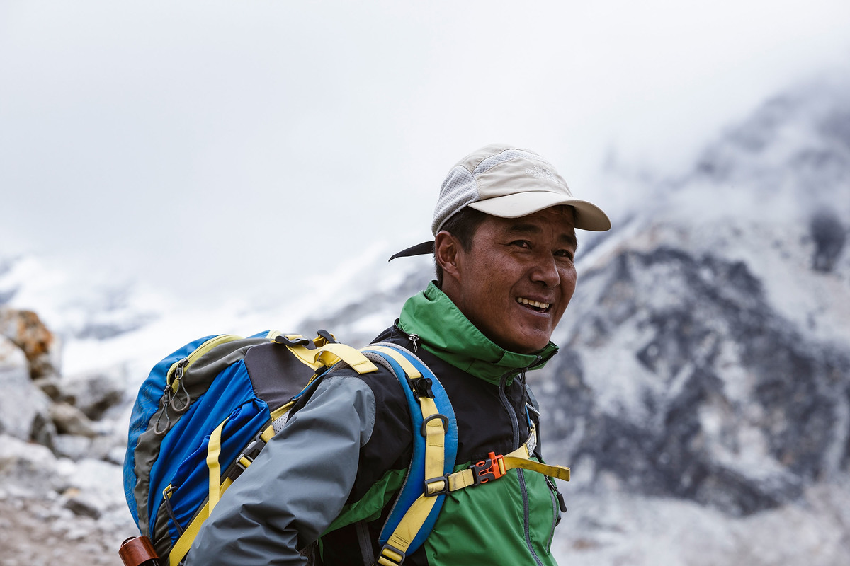 Mountain expedition sherpa and trekking guide Sange Sherpa hiking the trail