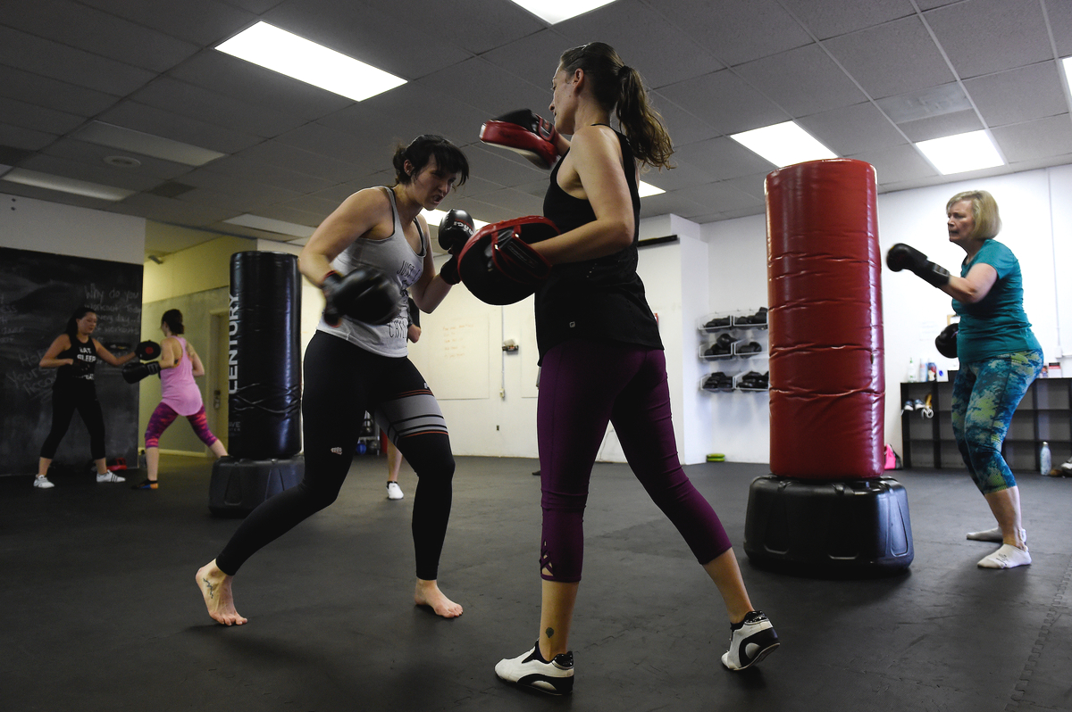 Rachel Ibarra throws punches into the mitts of Robin Woodburn during a kickboxing class at Palangi Fit on April 11, 2017, in Arvada, Colorado.