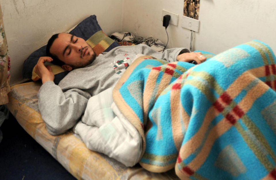 unisian student Aimen Jaabiri sleeps in his makeshift bed