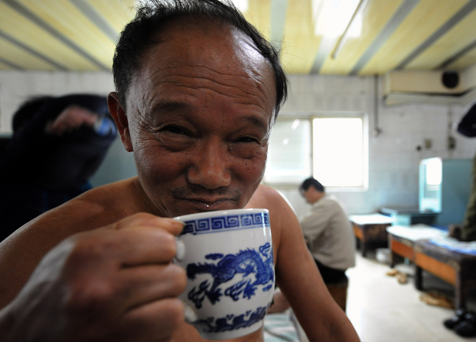 A Chinese man enjoys a cup of tea at a traditional bathhouse in Hefei.