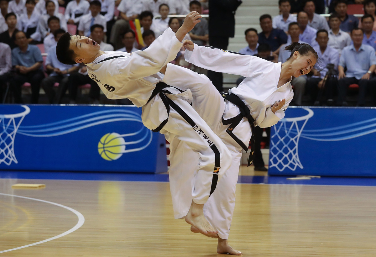 North Koreans perform martial arts Taekwondo during an inter-Korean basketball match at Ryugyong Chung Ju-yung Gymnasium on July 5, 2018 in Pyongyang, North Korea.