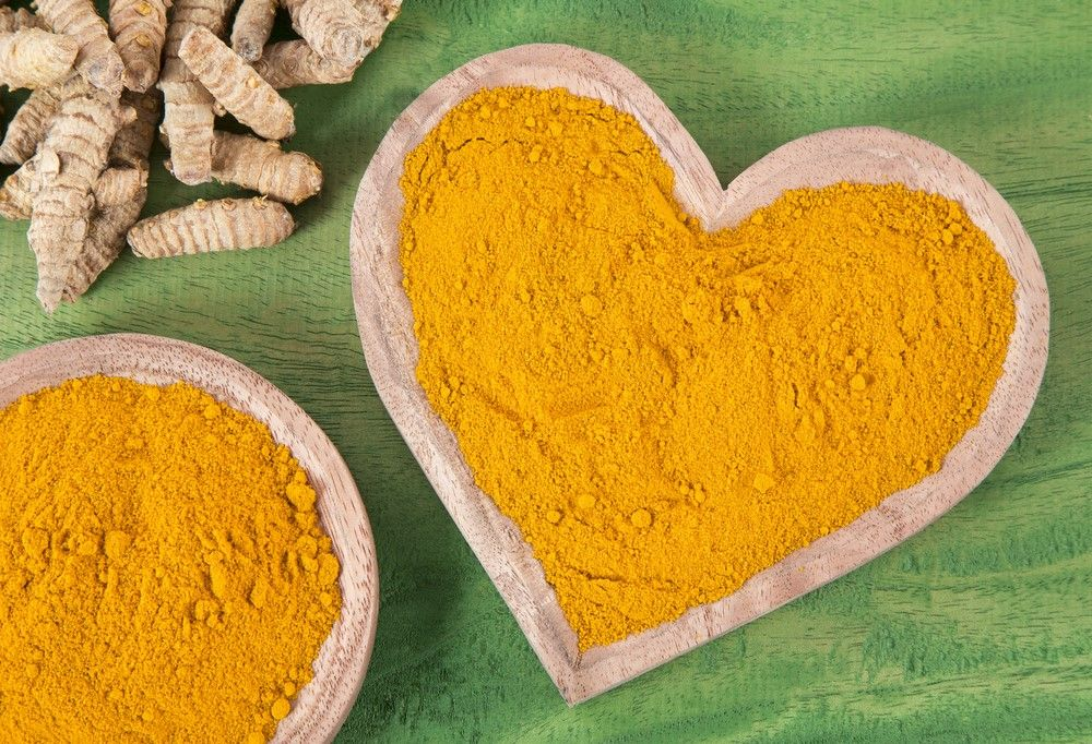 Powdered turmeric in a heart-shaped bowl