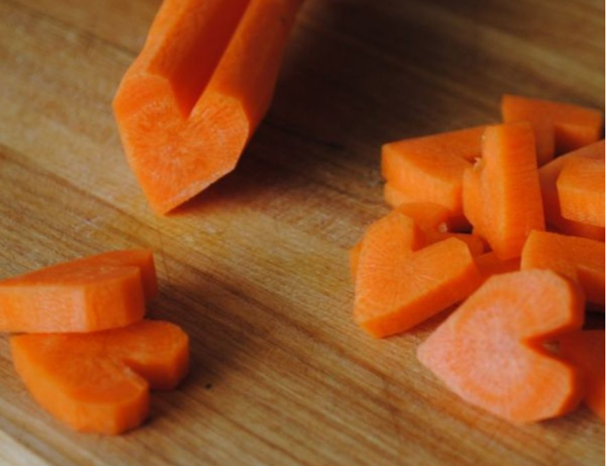 chopping carrots into heart shapes