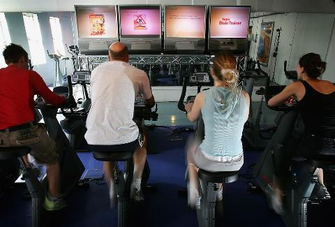 Men and women exercise in an effort to burn calories