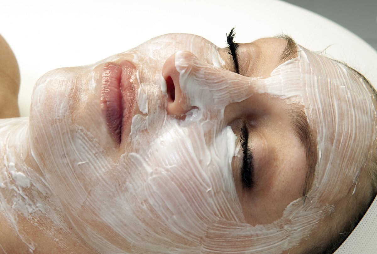 Woman getting a facial treatment at a spa...