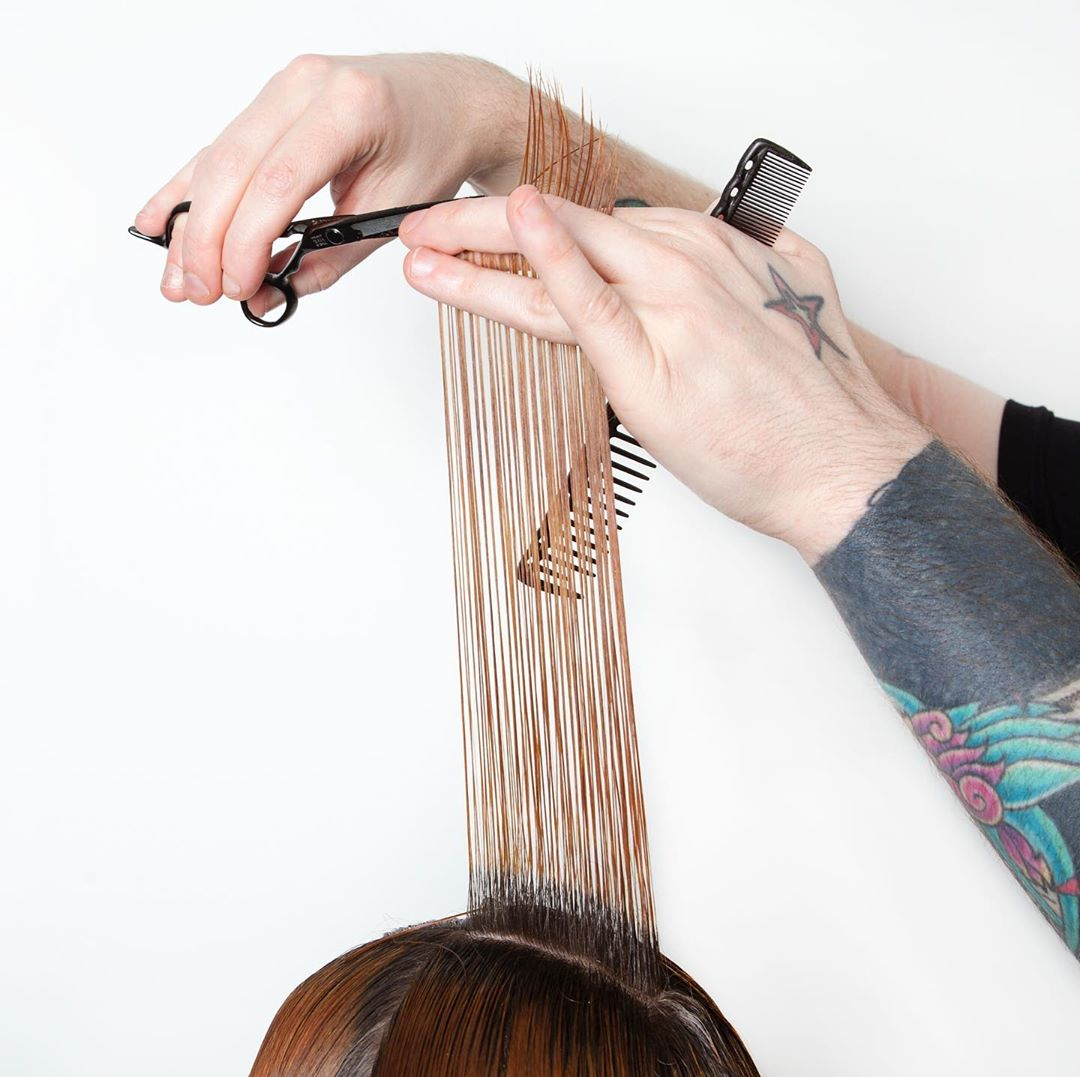 a hairdresser gives a haircut