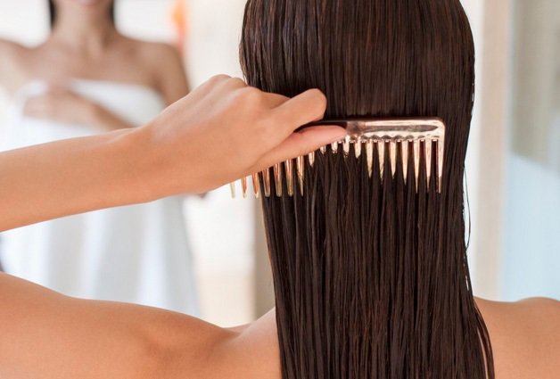 a woman combs her hair