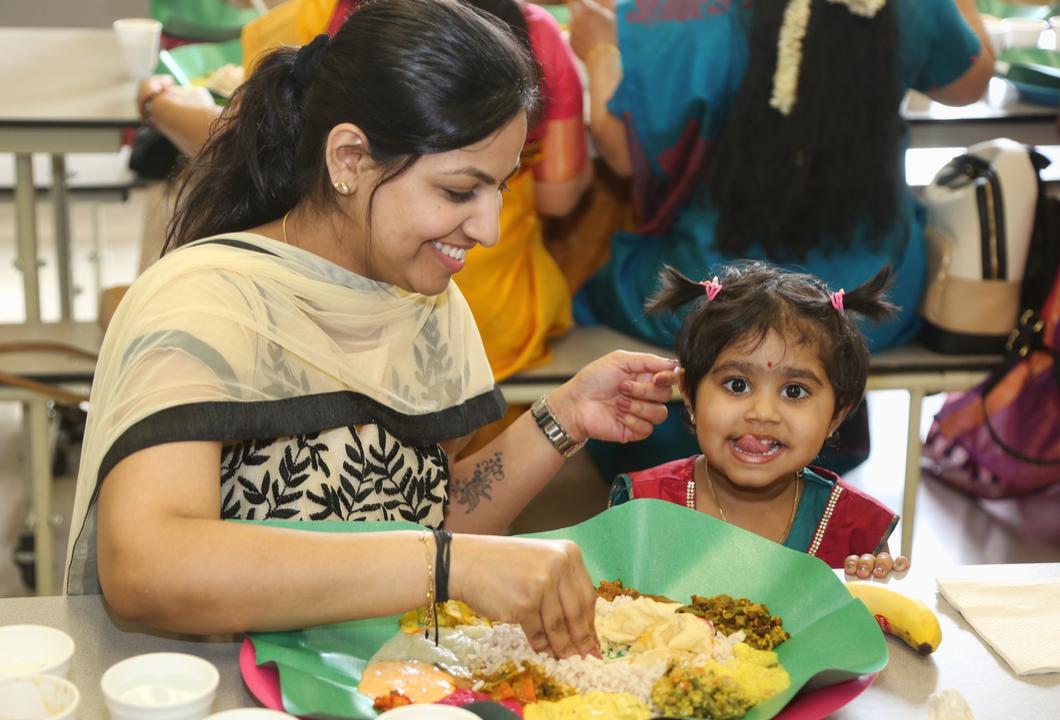 Malayalis enjoy a traditional Sadhya meal during the Vishu Festival in Ontario, Canada.