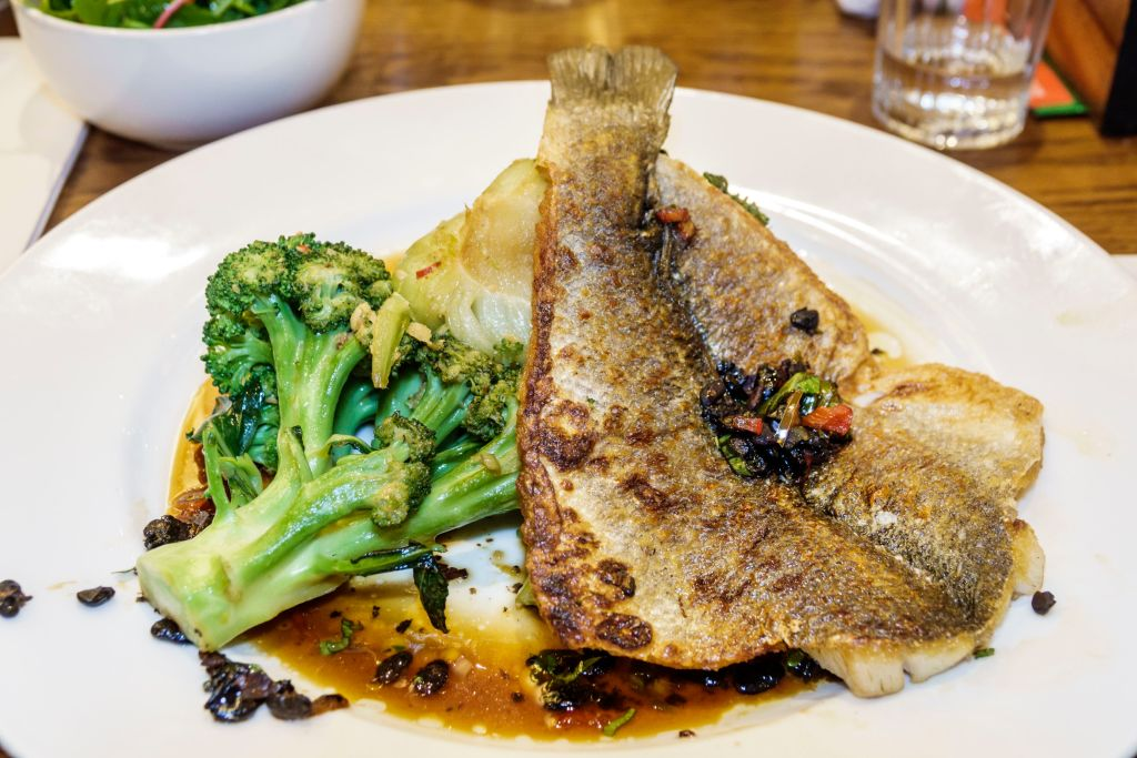 GettyImages-1140404079 sea bass with broccoli