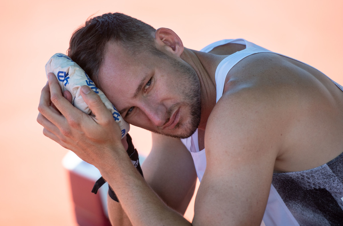 Decathlete Kai Kazmirek cools his forehead with an ice bag