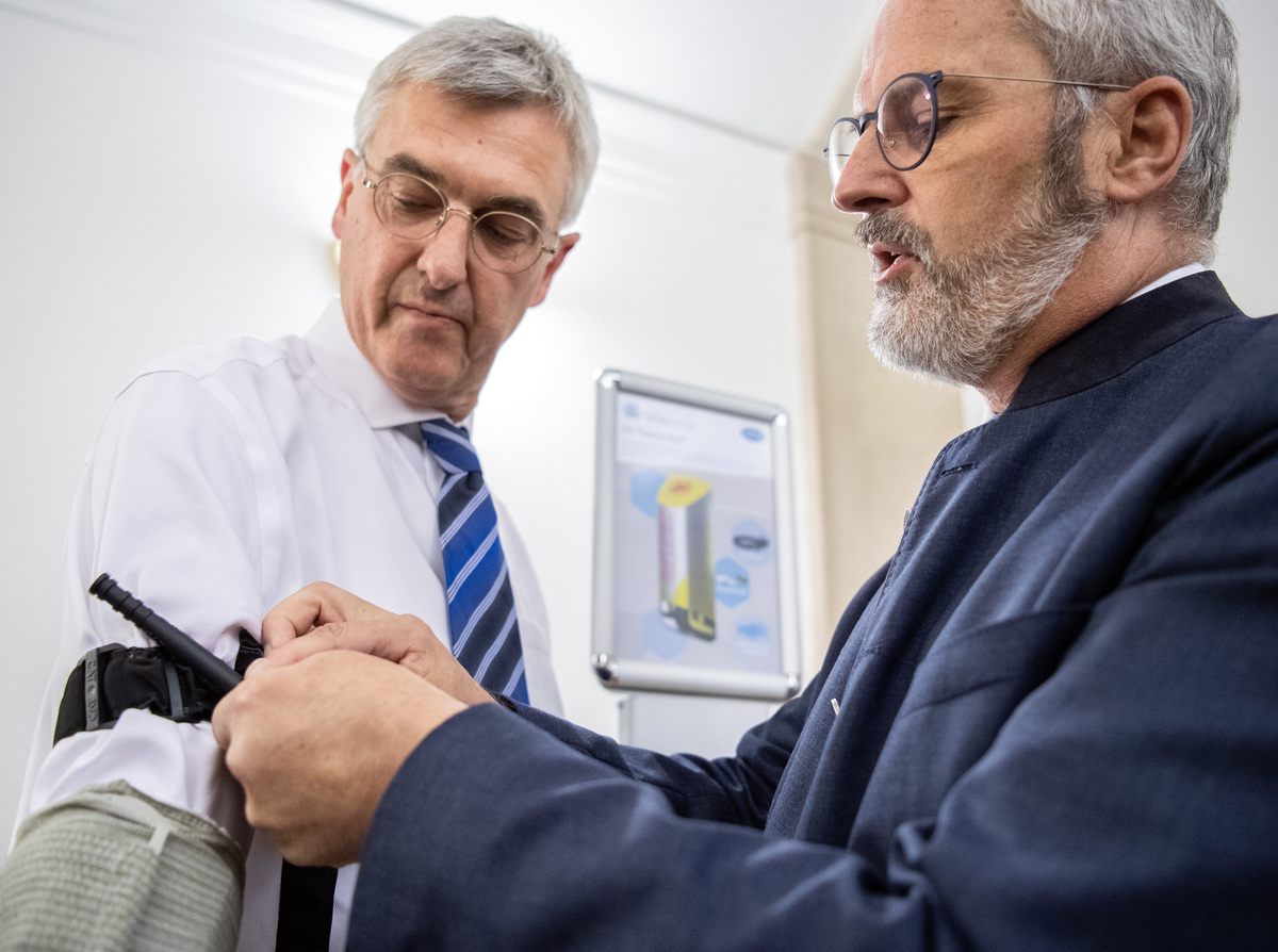 Doctor applying blood pressure cuff to a patient