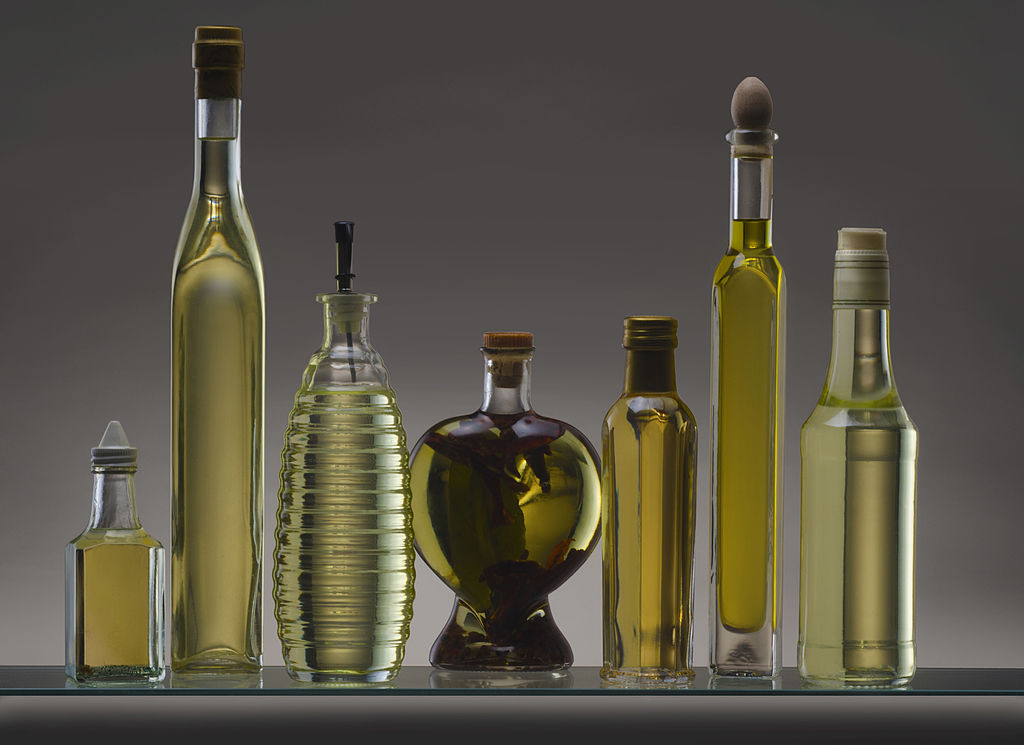 GettyImages-469502909 Still life featuring a collection of olive oil bottles