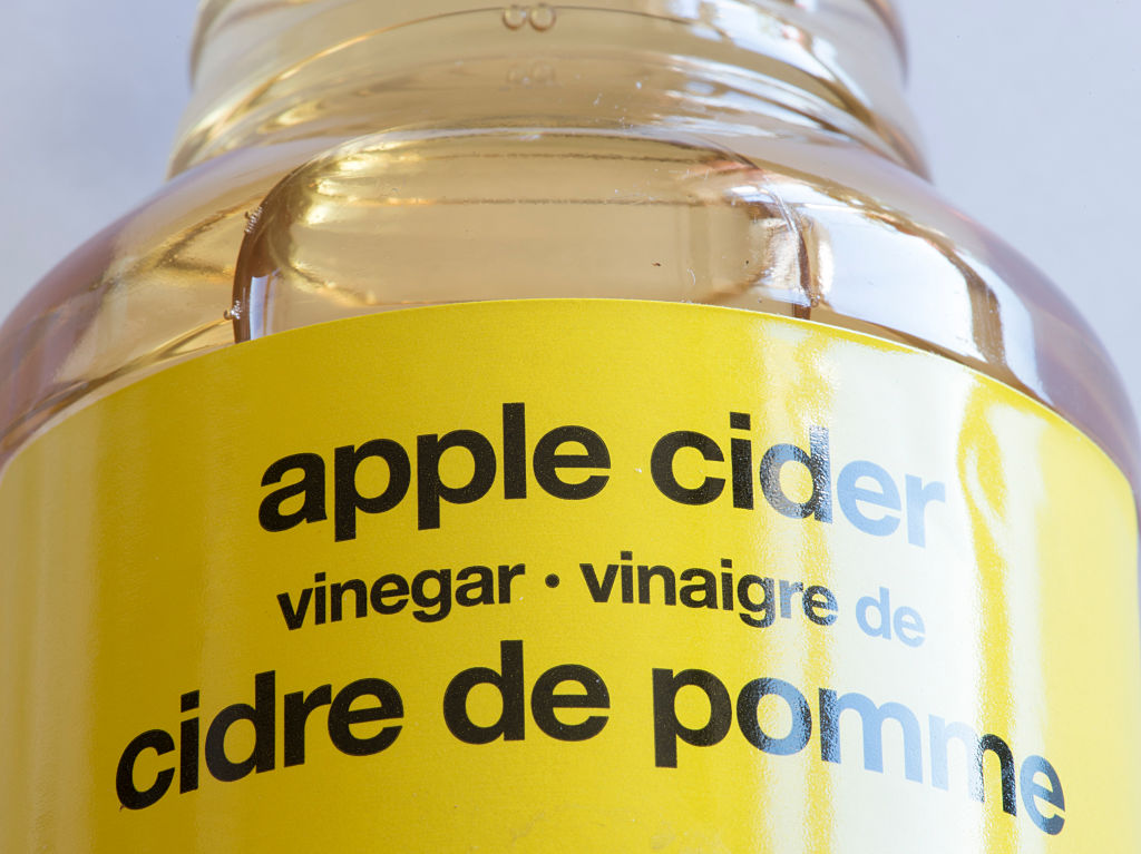 GettyImages-617941000 apple cider vinegar otherwise known as cider vinegar or ACV, is a type of vinegar made from cider or apple must and has a pale to medium amber color.