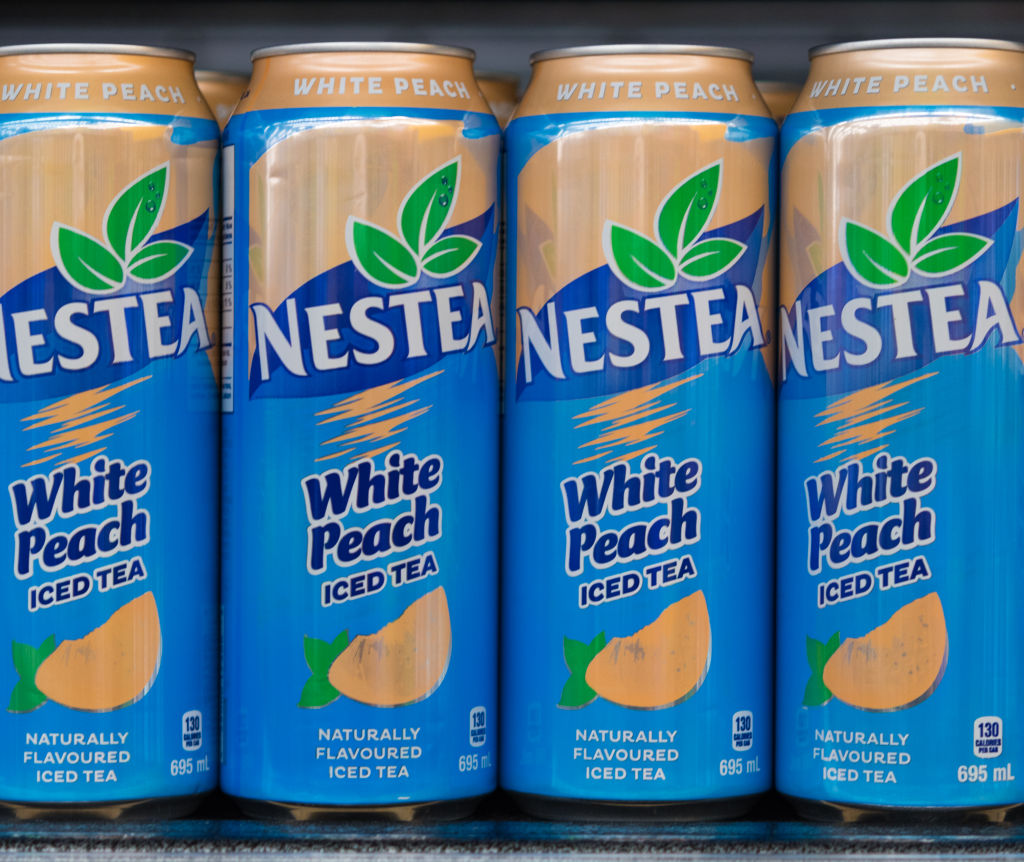 GettyImages-860371588 Nestea iced tea cans on a store shelf
