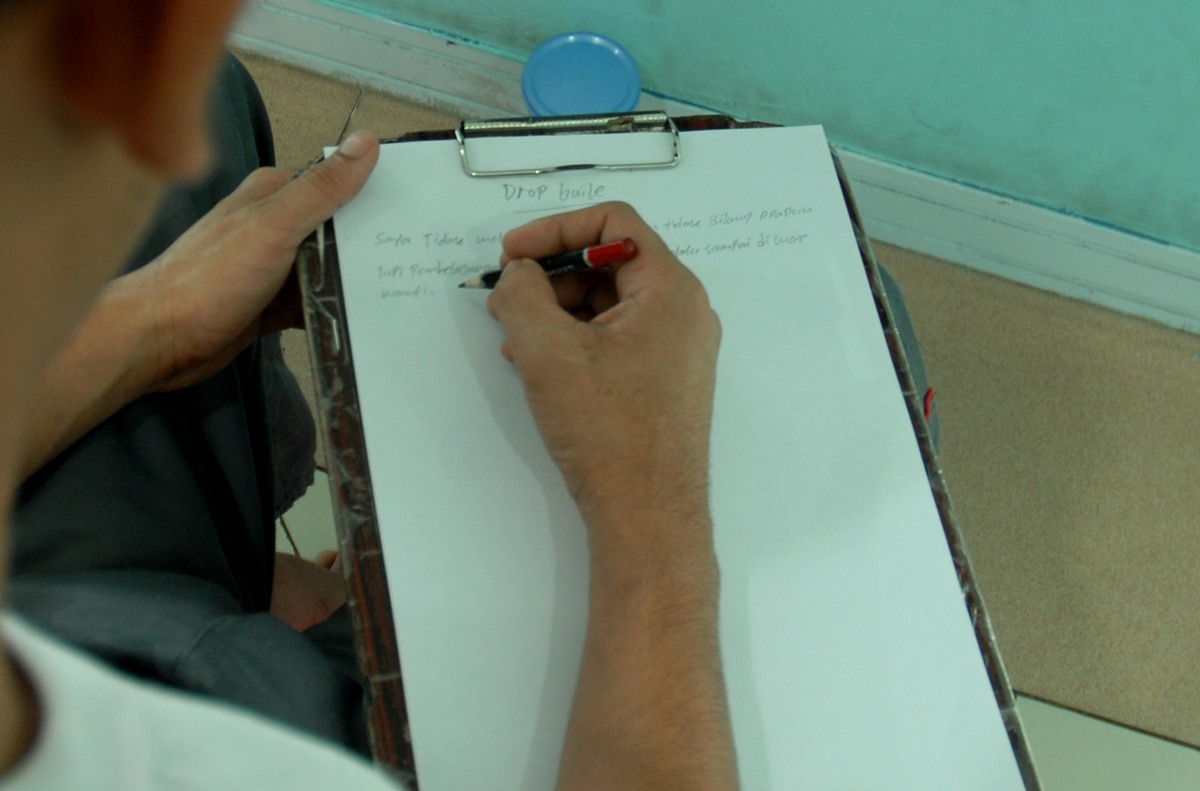 Writing a note at the National Narcotics Rehabilitation Center