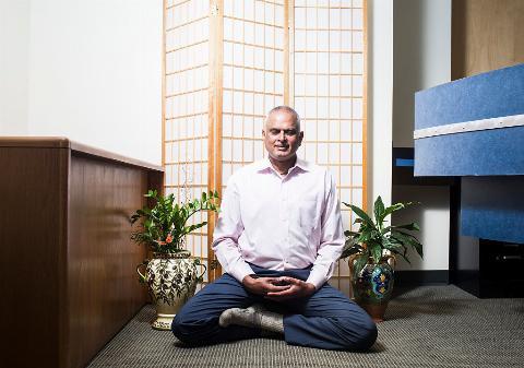 Ashok Nalamalapu meditating at his offic
