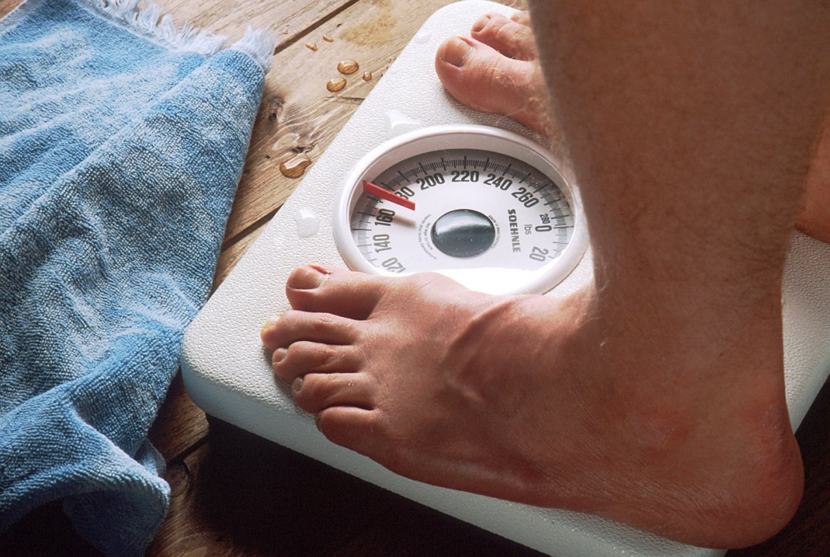 person standing on the weight scale