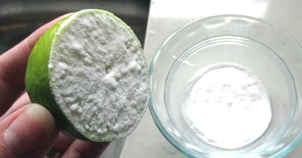a lime that's covered in baking soda with a bowl