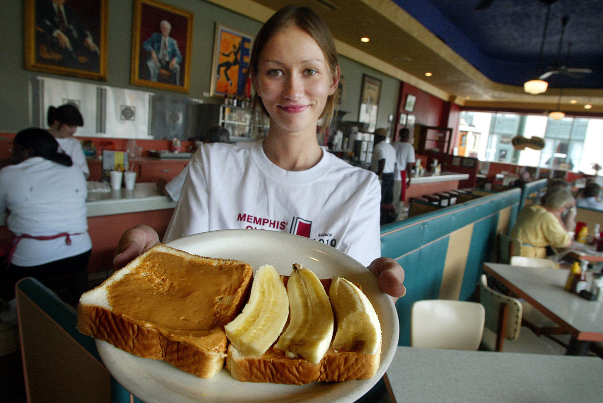Arcade restaurant waitress Julia Flowers holds a peanut butter and banana sandwich