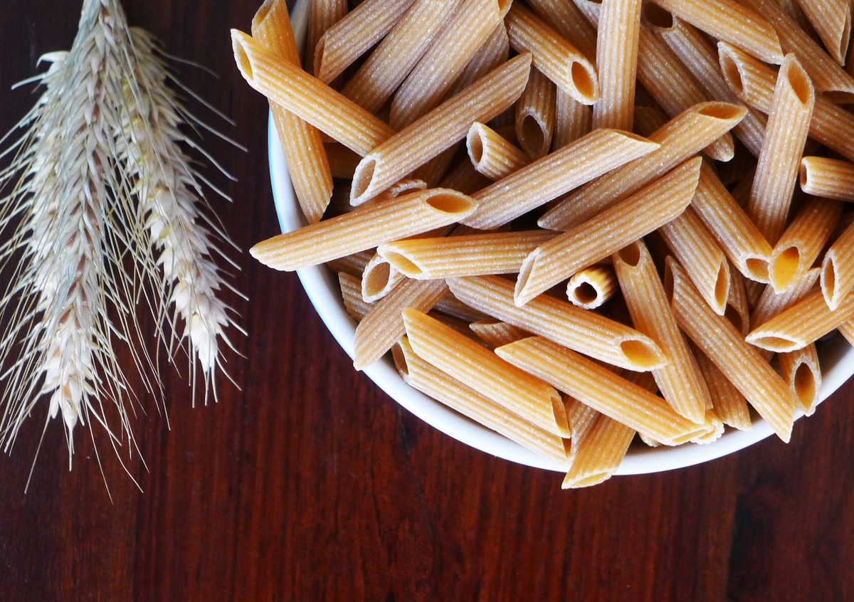 Whole wheat penne pasta in a bowl