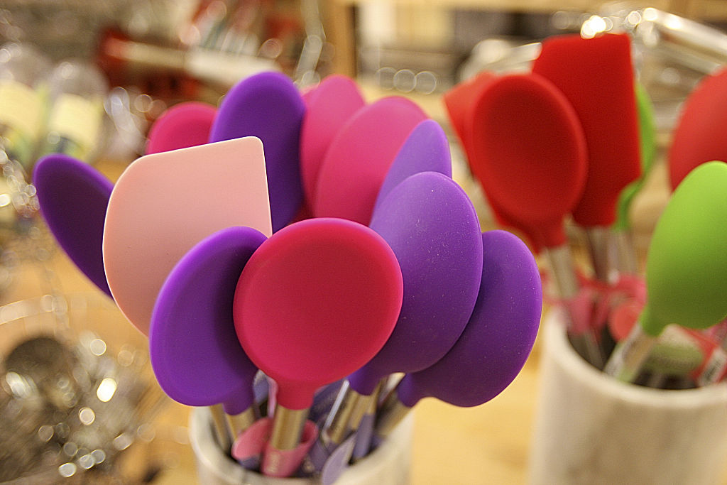 colorful spatulas on display at a store