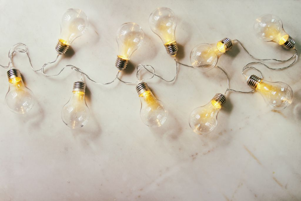 light bulbs strung out on a flat surface