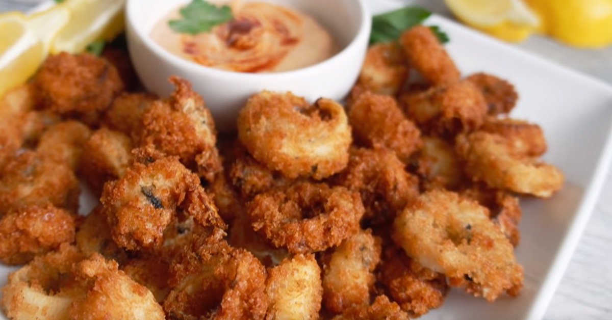 vegan calamari and shrimp with dipping sauce on a plate