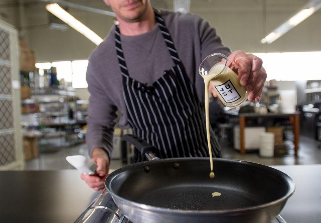 a chef making a vegan egg dish on a frying pan