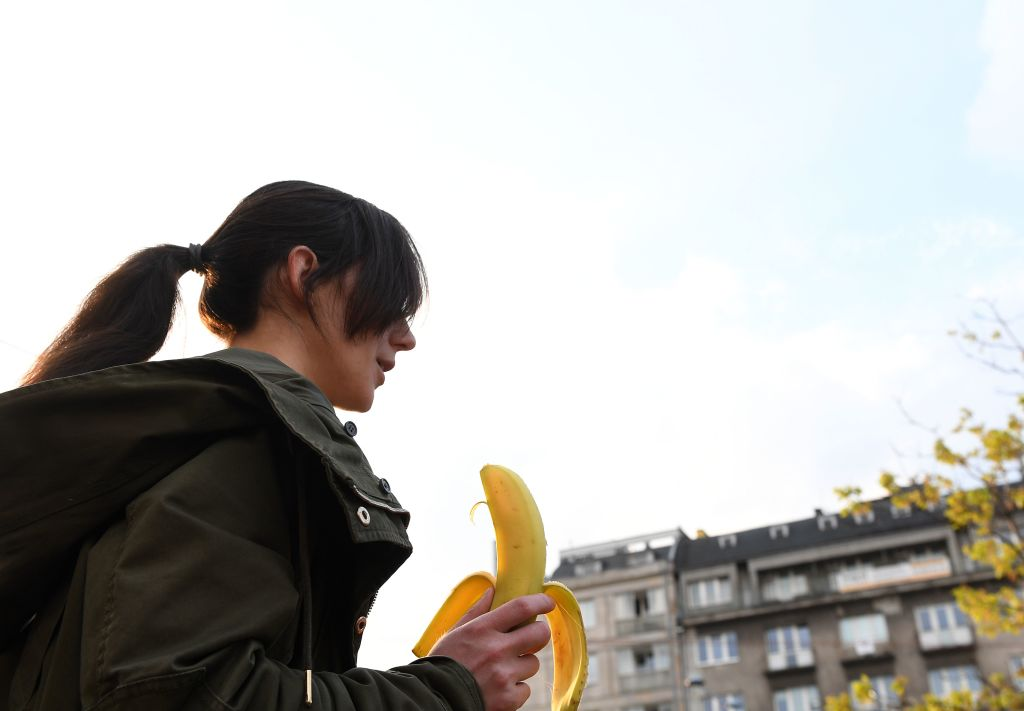 A woman with a banana