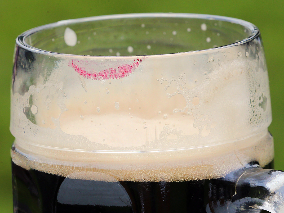 Lipstick smears can be seen on a glass of freshly tapped beer at a press conference regarding the 21st International Berlin Beer Festival