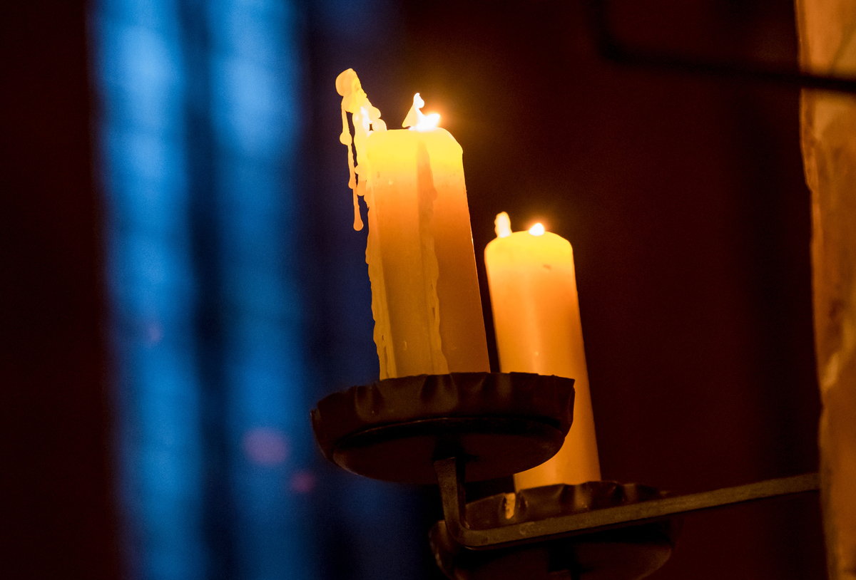 Candles burn at a Church during Christmas Eve service in Germany